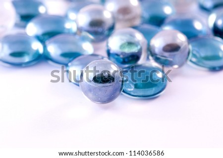 blue glass pebbles and marbles balls
