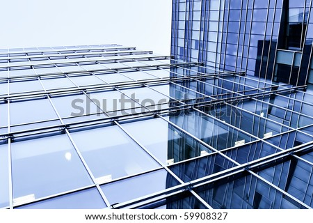 blue glass wall of modern commercial building