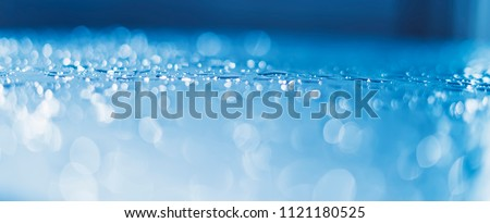 Blue glass with raindrops background texture horizontal top view isolated, rain on the window backdrop, abstract light bokeh and defocus drops, clear water on space blank back outdoors, mockup rainy
