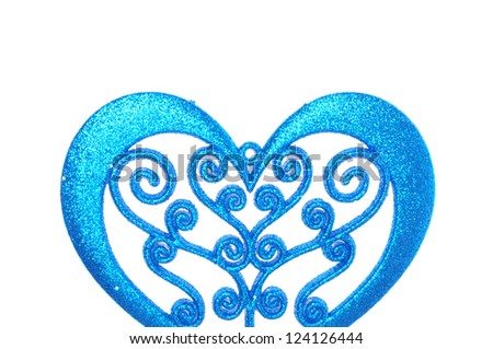 Blue glittering heart shaped decoration, isolated on white background. Valentines day ornament