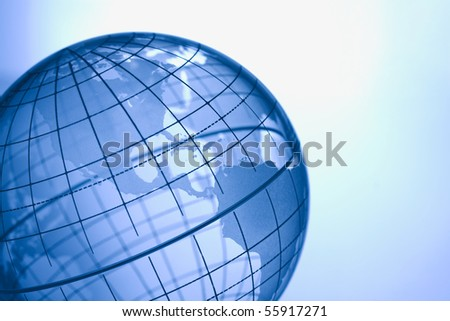 Blue globe showing North and South America.
