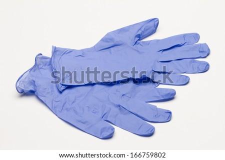 Blue gloves against white background, horizontal