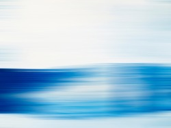 Blue gradient lines blurred in motion. Digitally generated image of blue light and stripes moving.