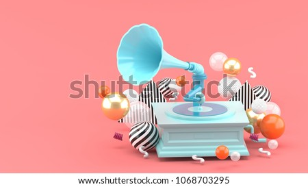 Blue gramophone amidst colorful balls on a pink background. - 3d render.
