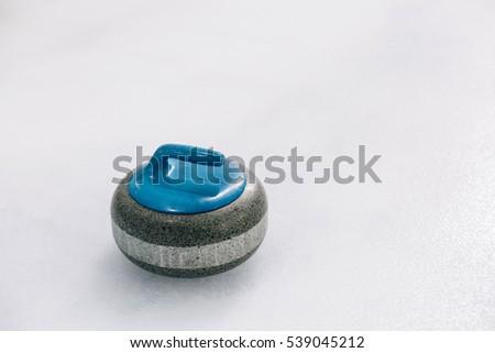 Blue Granite stone for curling game. Sport equipment