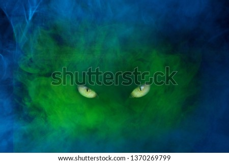 blue-green ghost with yellow shiny eyes and stern look the concept of mysticism and halloween #1370269799