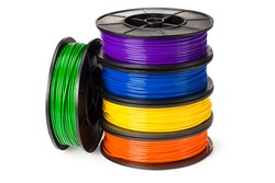 blue, green, violet, orange, yellow filament for 3d printer isolated on white background