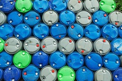 blue, grey and green oil barrels on a pile, Chemical Plant, Plastic Storage Drums,