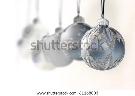 blue grey luxury christmas ornaments - focus on front ball - narrow DOF - stock photo