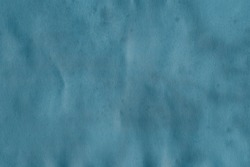 Blue grunge paper texture. Vintage background for design and scrapbooking. Old, compressed and crumpled effect.
