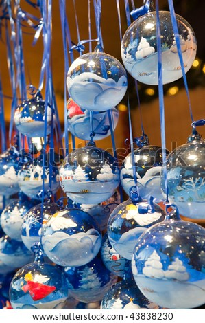 blue hand painted glass balls on the christmas market