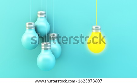 blue hanging lightbulbs with one switched on