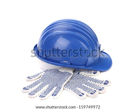 Blue hard hat and gloves. Isolated on a white background. - stock photo