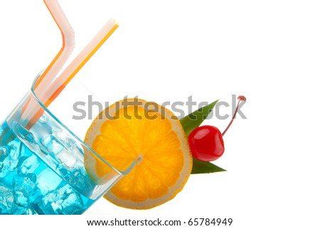 Blue hawaiian curacao cold cocktail decorated with orange,  pineapple and cherry, filled with ice isolated on a white background