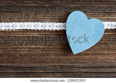 blue heart shape on brown wood