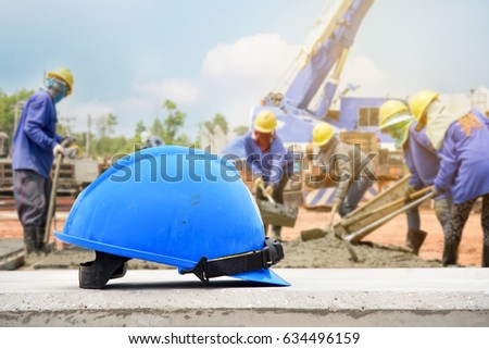 blue helmet in construction site and construction worker background, Construction site safety first concept