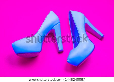 Blue high heeled shoes on pink purple background - top view concept - blank empty room space for text or copy. Classic fashion. Heels walking left. Dress up. #1448240087