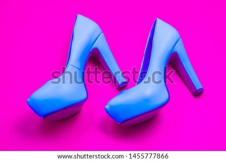 Blue high heeled shoes on pink purple background - top view concept - blank empty room space for text or copy. Classic fashion. Heels walking left. Dress up. #1455777866