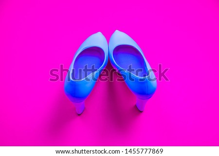 Blue high heeled shoes on pink purple background - top view concept - blank empty room space for text or copy. Classic dress up fashion. Heels pigeon toed #1455777869