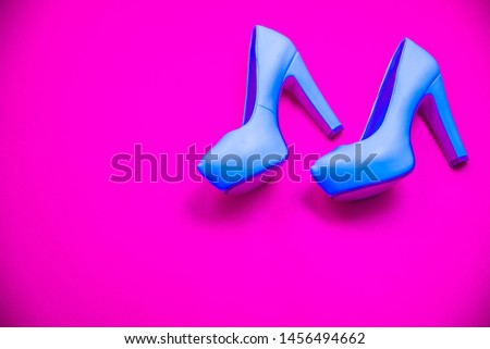 Blue high heeled shoes on pink purple background - top view concept - blank empty room space for text or copy. Classic fashion. Heels walking left. Dress up. #1456494662