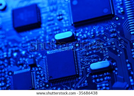 Blue high tech mother board with chip components background