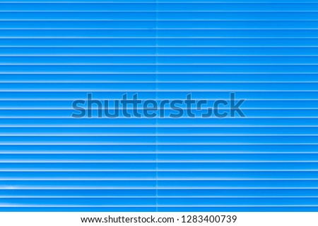 Blue horizontal grooved metal texture background
