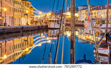blue hour at sunset on the port channel of Cesenatico, best tourist destination of the Romagna Riviera in Italy #785289772