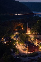 Blue hour light trails on a Summer night atop Maryland Heights overlooking the town of Harpers Ferry, West Virginia.
