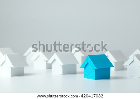 Blue house in among white houses for real estate property industry #420417082