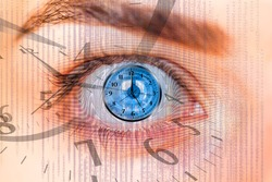 Blue human eye and clock