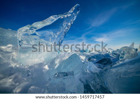 Blue ice and blue sky on Lake Baikal in Russia #1459717457
