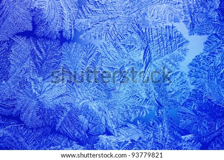 Blue Ice patterns made by the frost on the window