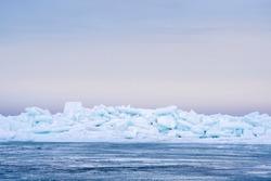 Blue ice piles on Tawas Bay in Lake Huron.