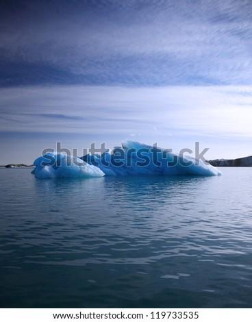 Blue iceberg floating on Jokulsarlon lagoon, Iceland