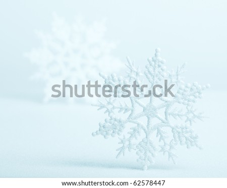Blue icy background with snowflakes, perfect for Christmas and winter