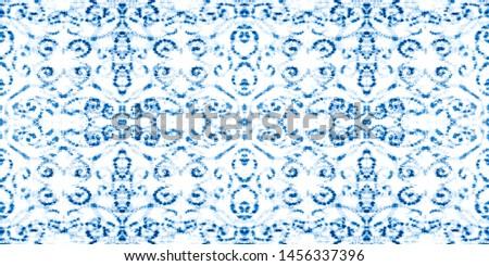Blue indigo seamless dirty art watercolor pattern. Rough paper texture. Textile print seamless pattern. Grunge wet illustration. Artwork fragment. Liquid painting. Surrealism art.