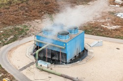 Blue industrial cooling tower at a chemical plant. Top view. Focus on the cooling tower