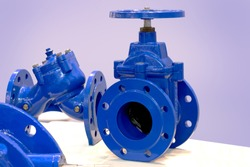 Blue industrial valves. Industrial pipeline wedge gate valve. Butterfly valve with reducer. Manual valve