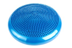 Blue inflatable balance disk isoleated on white background, It is also known as a stability disc, wobble disc, and balance cushion.