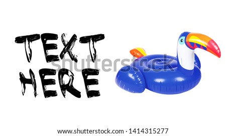Blue Inflatable Toucan Ride On Swimming Pool Float Isolated on White Background. Water Donut. Side View of Toroid-Shaped Baby Swim Ring. Water Sports Activities