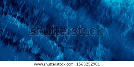 Blue Ink Printing Graphics .Painting Dirty Art. Abstract Watercolor Art. Paintbrush Drops Artwork. Blue Printing Graphics .Dirty Tie Dye Texture. Modern Fashion Watercolour.