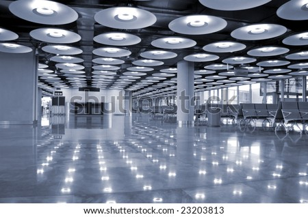blue interior perspective of airport in Madrid, Spain