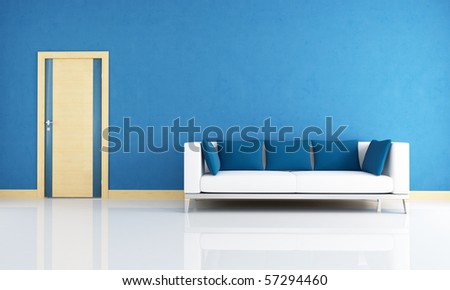 blue interior with modern couch and wooden door