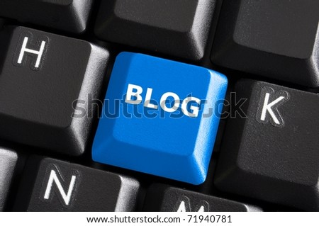 blue internet blog concept with button on computer keyboard