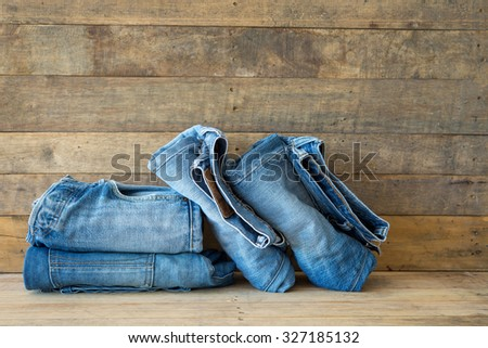 Blue jeans denim on wooden background