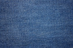 Blue jeans fabric background texture. Close up view.