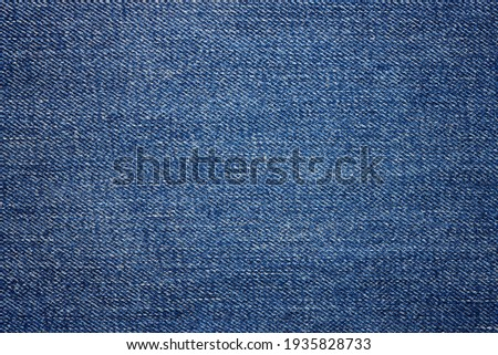 Blue jeans fabric background texture. Close up view. Stockfoto ©