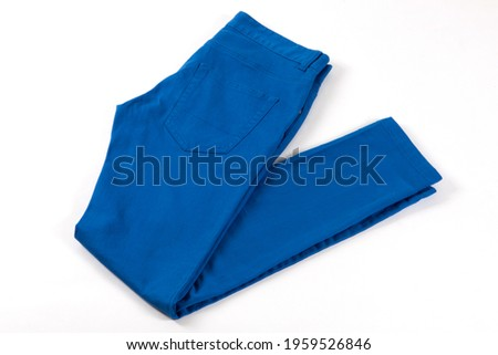 Blue jeans isolated on white background. Folded casual style trousers or pants.  Stockfoto ©