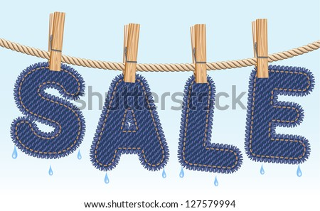 Blue jeans SALE word drying on a clothesline. Raster version. Vector is also available in my gallery - stock photo