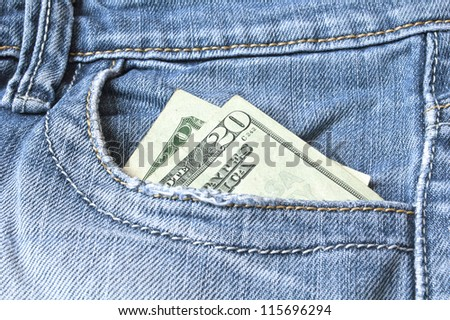 Blue jeans with american 20 dollar bill on its pocket
